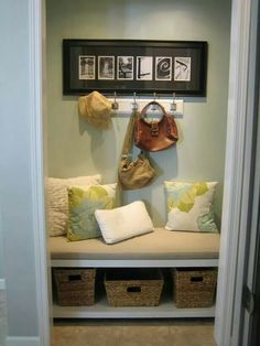 Nook in closet. Love the framed last name.
