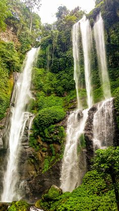 "Sekumpul Waterfall, Bali. Indonesia. While Gitgit is the most visited waterfall in Bali and Aling-Aling is the most fun waterfall, the Sekumpul waterfalls are often considered the most beautiful in Bali. Sekumpul means ""a group of"", and there are 7 waterfalls here on the north side of Bali (further east of Lovina) that you can view. The drive is long and it takes a whole day, but you'll barely meet other visitors there and the pure serenity that awaits you is unforgettable!"