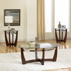 Apollo 3 Piece Coffee Table Set by Standard Furniture. $308.70. 22993 Features: -Veneer application.-Legs overlap in the center.-Removable and easy to clean glass tops.-Care: Surfaces clean easily with a soft cloth.-General conformity certified. Includes: -Set includes one cocktail table and two end tables. Construction: -Select solid wood construction. Color/Finish: -Deep brown cherry finish.-Brushed metal color stretchers attached to the table legs make it durable and s...