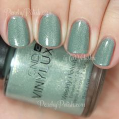 "CND's Vinylux Spring Collection 2015: ""Wild Moss"" is a sage green with loads of strong gold and silver flakies and shimmer."