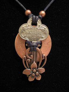 urban artifact necklace - vintage key, copper washer, copper floral jewelry component, copper beads.