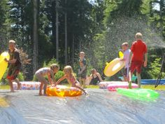 Giant Slip N Slide | But combining Duct Tape, grommets, and stakes with the weight of water ...