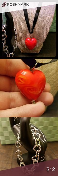 """Heart jewelry bundle Cute heart pendant with a glass-like appearance, subtle red swirls, on a black ribbon with lobster clasp. Total length 18-20.5"""". Interlocking silver heart bracelet with lobster clasp.  Willing to sell separately or make a custom bundle with my other jewelry--just ask! 😉❤ Jewelry"""