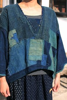SASAKI-JIRUSHI (Japanese Boro)  Japanese boro indigo cotton patchwork blouse  Made by us.  Material:Antique cotton,19th century.Japan.  Color:Mixed indigo.  This fabric has many stains and damages because made in 19th century for Japanese farmers.   Size: Neck to cuff : 23.2 inch (59 cm) Chest measurement : 49.6 inch(126 cm) Dress length: 23.6 inch (60 cm)  Model:52(157 cm)  Thank you!!! ------------------------------------------------------------------------------------------  Our store…