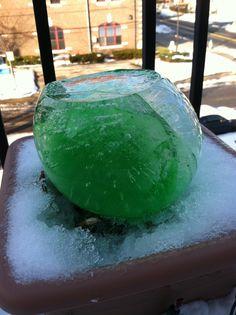 Green ice ball. Ballon, water,food coloring, time.
