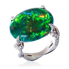 One 15.17 carat cabochon shaped black opal set with 1.0 carat tcw in round brilliant cut diamonds in a hand fabricated platinum setting.
