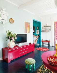 as so rightly pointed out by midkid - the colour spills through from the other room on the arcitraving - so clever! i love the combo of pink and teal too.