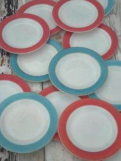 vintage Pyrex plates, aqua & flamingo pink colored band milk glass plates