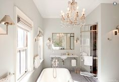 hello lovely vintage bathroom...love this bath and the chandelier