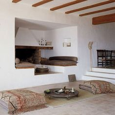 a little nook with a fireplace and exposed wood beams