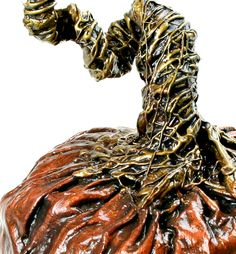 Sculpture artist Jessica Dvergsten's metallic copper and antique gold paper mache pumpkin.