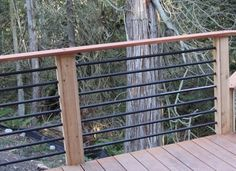 Deck Plans 384565255662488506 - Metal bars fitted into a pre-drilled wood frame Source by espicky Horizontal Deck Railing, Metal Deck Railing, Diy Stair Railing, Pipe Railing, Deck Railing Design, Patio Railing, Deck With Pergola, Deck Design, Deck Railing Ideas Diy