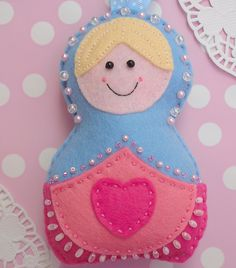 Russian Doll Decoration By Sew Sweet @Tony Wang: I am obsessed with Russian dolls! This one is cut and stitched by hand from soft wool-mix felt, stuffed with polyester toy filling and features appliquéd decoration, seed beads & faux pearls. She's finished with a really lovely baby blue polka-dot grosgrain ribbon--too cute! (I LOVE the pears!!!)