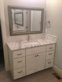 Painted White Bathroom Vanity Cabinet with Drawers. Learn More: Builder Preferred Cabinetry Serving Wichita/Metro, KS