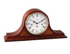 Hermle Remington Tambour Mantel Clock 21162-N90340-N91050. h1Hermle Remington Tambour Mantel Clock 21162-N90340-N91050_h1The Hermle Remington Tambour Mantel Clock 21162-N90340-N91050 features fan corner inlays that compliment the Roman numeral ivory colored dial with simple black.. . See More Mantel Clocks at http://www.ourgreatshop.com/Mantel-Clocks-C1124.aspx