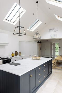 The Coach House Kitchen | deVOL Kitchens Darker island, lighter cabinets