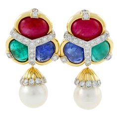 18kt yellow gold David Webb earclips set with diamonds, two South Sea pearls and cabochon rubies, sapphires and emeralds.