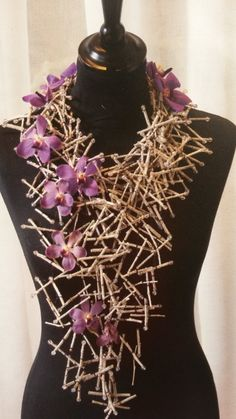 Floral necklace made with purple Vanda orchids finished of with some beads