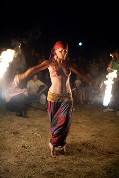 fire dancer... you can hear the hand drum rhythms driving the dancer on and inviting the others to join in...