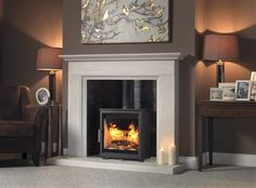 Britain`s Heritage Fireline Woodtec 5KW Stove Wide and Aylesbury Suite surround,chamber and hearth.
