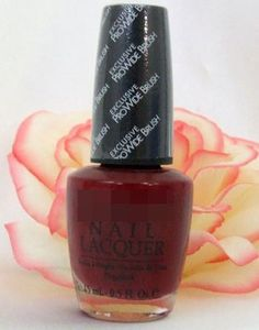 This deep red nail polish and the rose in the back round show the different ages shopping in the non pink section...all the way from 13(the rose) - 55(the nail polish)
