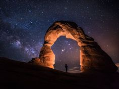 Delicate Arch lit at night in Arches National Park, Utah Would be a great place to camp out under the stars...