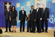 • Dr Moses De-Gaulle Dogbatsey (3rd right), the Administrator, Mrs Juliana Dogbatsey (second left), their son, Moses De-Gaulle Kofi Dogbatsey Jnr. (with the award), with some officials of the BID Group.