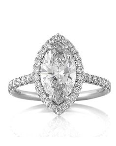 This mesmerizing marquise cut diamond engagement ring is one in a million! The incredible 1.80ct marquise cut center diamond is GIA certified at H-SI2. It is perfectly white, eye clean and the cut is outstanding! It looks as large as most two carats diamonds and even larger! It is accented by a halo of round diamonds and a row of round diamonds set down the sides in a micropave setting. The diamonds are showcased perfectly in high polish platinum with minimal metal showing. The center…