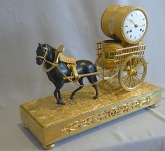 French Empire viticulture genre related mantel clock of horse pulling grapes at Gavin Douglas Fine Antiques Ltd. in London, specialists in antique clocks and decorative gilt bronze Antique Mantel Clocks, Mantle Clock, Art Decor, Decoration, Radios, French Clock, Classic Clocks, Clock Shop, Clock Art