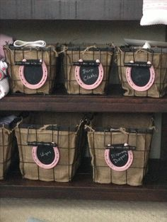 Painted horse shoes with chalkboard back. Two little clips/hooks on the back so I can use them anywhere! My dad made these for the nursery changing table baskets.
