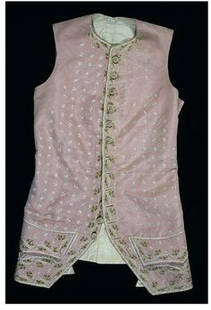 Waistcoat, France, 1775-80. Pink silk overlaid with machine-made net and embroidered in colored silks. Pink was a popular color for men's dress, particularly in the 1770s during the period of the Macaronis – as young dandies, who dressed in the latest French and Italian styles on returning from the Grand Tour were known. This waistcoat is typical in style for the 1770s; the skirts have shortened to the top of the thigh.
