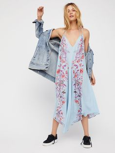 Ashbury Printed Slip | Semi-sheer midi slip featuring delicate flowers allover with a plunging V-neckline and a strappy criss-cross back detail.