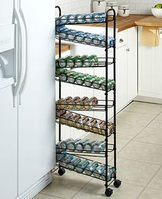 The Slim Rolling Can Organizer keeps your kitchen organized without taking up too much space. It features 4 auto-rotating shelves that are easily loaded from th