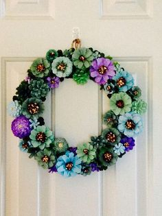 Hand painted Pine Cone Wreath. 13.5 x 13.5 diameter. Each pine cone is hand painted. Not recommended for outdoor use.: