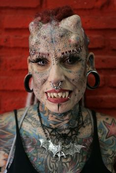 """Maria Jose Cristerna, a mother of four, tattoo artist and former lawyer, poses for a photograph in Guadalajara March 8, 2012. Cristerna, dubbed """"Vampire Woman,"""" prefers to be identified as """"Jaguar Woman."""" #tattoo #body #mod #modification"""
