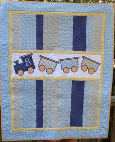 (front) boys quilt with trains for Scout by Ginny Watson