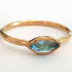 Hey, I found this really awesome Etsy listing at https://www.etsy.com/listing/210955807/blue-topaz-ring-gold-ring-marquise