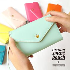 Handmade crown smartphone pouch wallet K with strap by Donbook. The Handmade Crown Smartphone Pouch is a very useful and well made smartphone pouch. The All in one pouch wallet features a wallet and cellphone(smartphone) pouch at one time. Leather Clutch Bags, Leather Wallet, Pu Leather, Leather Purses, Leather Handbags, Galaxy S2, Samsung Galaxy, Samsung S2, Clutch Wallet