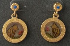 Winnie the Pooh Pierced Earrings Disney. Gold toned earrings with Winnie the Pooh looking at a red flower in center. Saying around earring circle reads time for a little something. Top portion is a small gold flower with a blue stone center.