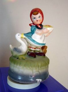 I had one of these as a child.  Wish I had been more careful with it.  Vintage Little Girl and Duck Music Box Plays Love Story