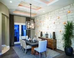 A dining room with a unique wall allowing for subtle lighting. (Toll Brothers at Los Saguaros, AZ)