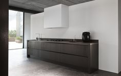 Kitchens - Piet Boon by WARENDORF - LONDON - A wrap around dark offset rail creates perfect harmony