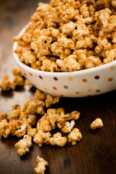Caramel Popcorn: 1 c butter , 2 c Br Sugar, 1 tsp salt, 1/2 c corn syrup, 1 tsp baking soda.Combine first 4 ingreds and boil for 5 mins. Remove from heat; stir in b soda.  Pour over 8 quarts popped corn.  Stir to coat well.  Bake in large roaster or pan at 200 degrees for 1 hour, stirring every 15 minutes.  Spread on waxed paper to dry.