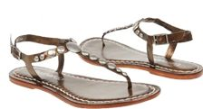Flat sandals - cute enough for a night out, but sturdy enough for the beach & comfortable for a day's walking in a hot climate.