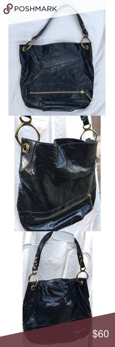 "SALE.. orYANI Black patent leather hobo purse orYANY black patent leather hobo purse with brass details. 1 exterior zipper pocket, 2 interior zipper pockets, 2 interior slip pockets. Comes with original storage bag. 14""Hx15.5""W. Lightly used orYANY Bags Hobos"