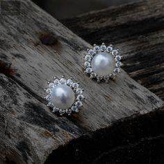 Studs that are attractive to eyes that gives an added beauty to women and girls #silver #silverjewellery #pearls #pearljewellery #zirconiastones #studs #silverstuds #beautifulearrings #silverstore #pearlearrings #silverornaments #pearlstuds #earringswithpearls #stonedearrings #earringswithstone