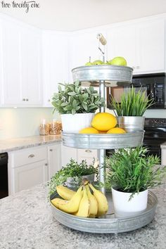 Needed inspiration for my kitchen!  I loved this tiered tray for plants and fruit :) This is a great way to save counter space while brightening up the kitchen. I bet this could even be spray painted! So easy to make.  Are you looking for how to decorate your kitchen while saving counter space? This looks perfect!