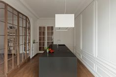 Hidden kitchen in a Paris apartment designed by I29 Interior Architects