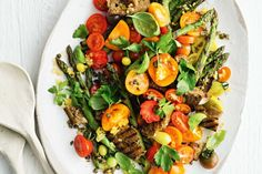 Grilled asparagus and tomato salad with preserved lemon - This delicious salad is ideal in summer when tomatoes are at their peak. The combo of herbs with the preserved lemon dressing is the secret to this salad, adding loads od flavour, without extra fat.