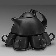 "Small Set for Six  Small Set for Six (porcelain, black glaze) nine-piece set: pot (24oz), lid, six cups (2oz), tray   9""x8""x8"" - $140 – order    Excellent for serving green tea or espresso. Pot rests on tray. Cups can be removed without lifting the pot."